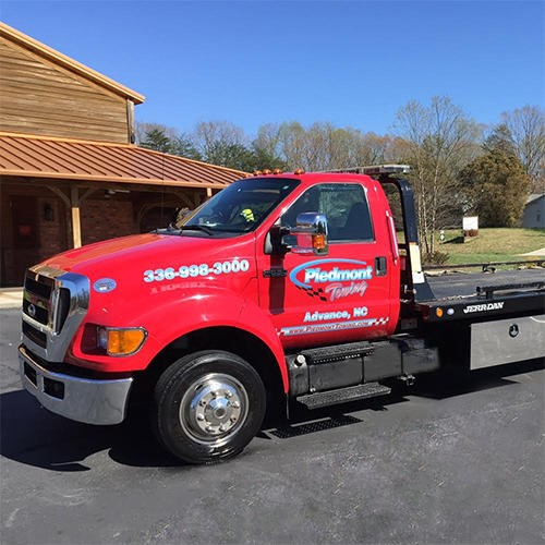 "From unexpected breakdowns to fender-benders & major wrecks, the time to call for HELP is not the time to start your search for a reputable towing company near Lexington, NC. Even though jumpstarts & lockout services may seem like easy tasks to perform, an inexperienced or un-trained provider could cause more harm than good. Winch-outs require skill & advanced equipment to ensure your vehicle isn't damaged during the procedure. When you are stressed out after an accident, you might just call the first number you find without checking the company's reputation; or accept the assistance of a provider who just ""shows up"" on the scene. Either could result in a price you weren't willing to pay for towing and/or hidden storage fees. Do your research before you need help and we think you'll find Piedmont Towing ""is tow-tally the wrecker service for all your towing needs."" REFERRALS & ONLINE SEARCHES. Asking for recommendations from family & friends is a great place to start, but we still recommend you research any towing company (even those referred by trusted sources) before you program its number into your cell phone. Jump on the internet to research their online presence and reputation by typing ""towing service near me"" into your search engine. Companies with an informative website, industry affiliations and positive reviews are most likely to be legitimate. Visit Piedmont Towing dot com to learn more us, view our association memberships, and click on links to Facebook, Google + and Yelp to read our glowing customer reviews. Accredited by the Better Business Bureau, we have been providing superior light & medium towing plus, roadside assistance near Lexington, NC for nearly 15 years. BE AWARE OF TOWING SCAMS. Don't be tempted to choose a provider solely based on price. Some ""towing scams"" advertise a low price then tack on an additional fee per mile to rack up a high bill. In addition to low base prices & high mileage rates, some unscrupulous operators may charge exorbitant administration fees, daily storage or other unexpected charges. When they've got your vehicle locked behind a fence, they have you at a disadvantage. Our membership in the Towing & Recovery Professionals of North Carolina, the North Carolina Police Benevolent Association, North Carolina Sheriff's Association and the Davie County, North Carolina Chamber of Commerce, is your assurance that Piedmont Towing is a legitimate company committed to your satisfaction. Better Business Accredited, we are always honest, and upfront about pricing. You always know where you stand with Piedmont Towing. STICK WITH YOUR CHOICE. So, you've made your choice and programmed the number to Piedmont Towing into your cell phone. Now days, months or perhaps even years later, you need help. For roadside assistance, just give us a call and we'll dispatch a truck to your location ASAP. If you've been involved in an accident, make sure everyone is fine, call police and then call us. While you are waiting, be wary of any tow truck that just ""happens"" to show up. The operator could be a ""scanner listener"" who taps into police radio transmissions to troll for business. The National Insurance Crime Bureau recommends that you NEVER give permission to a tow truck operator, who arrives unsolicited, to take your vehicle. Wait for police and Piedmont Towing to arrive! We're ""tow-tally"" the wrecker service for all your towing needs."
